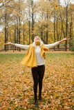 Happy girl in fall park outdoors.  Stock Photo
