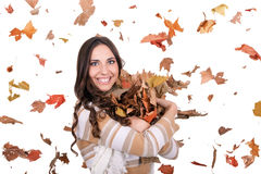 Happy girl with falling leaves Stock Photo