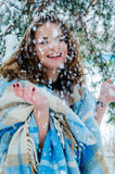 Happy girl and falling snowflakes Stock Photo