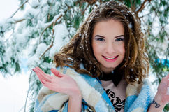 Happy girl and falling snowflakes Stock Image