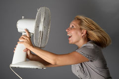 Happy girl with a fan Royalty Free Stock Image