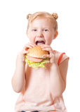 Happy girl with fastfood Royalty Free Stock Image