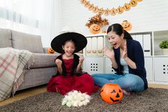 Happy girl feel success and her shocked mother Stock Photography