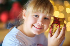 Happy girl in a festive interior. royalty free stock images