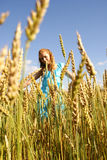 The happy girl in the field. The happy beautiful girl in the field Royalty Free Stock Photos