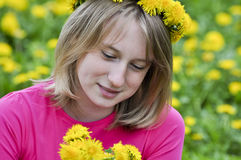 Happy girl in the field of dandelions Royalty Free Stock Photography