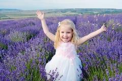 Happy girl in field Stock Photos
