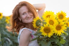Girl and sunflowers stock photo