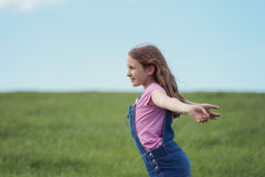 Happy girl in field Royalty Free Stock Image