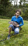 Happy Girl Fishing Stock Images