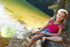 Happy girl fishing at lake Royalty Free Stock Photography