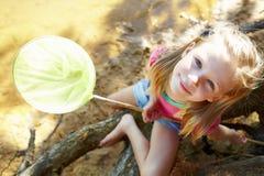 Happy girl fishing at lake Stock Image