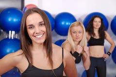 Happy girl in fitness studio Stock Photos