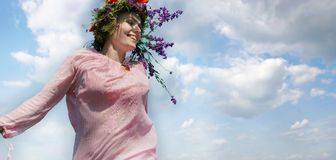 Happy girl in floral wreath Stock Photo