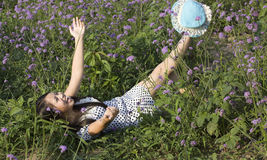 A happy girl in flower Royalty Free Stock Images