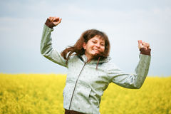 Happy girl in flower field Royalty Free Stock Photography