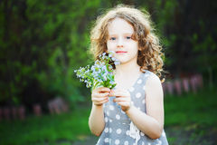 Happy girl with a flower in her hand. Mothers day concept. Stock Photo