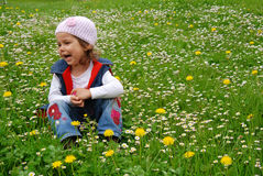 Happy girl in flower meadow royalty free stock photo
