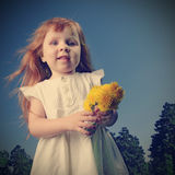 Happy girl  with flower Stock Images