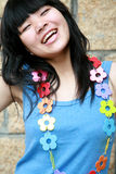 Happy girl with flowers. Happy girl wearing a chain of flowers Royalty Free Stock Photo