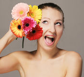 Happy girl with flowers Stock Photos