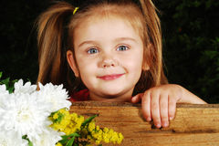 Happy girl and flowers Royalty Free Stock Image
