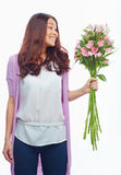 Happy girl with flowers Stock Photography