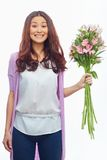 Happy girl with flowers Royalty Free Stock Photography