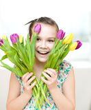 Happy girl with flowers Royalty Free Stock Photos