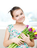 Happy girl with flowers Stock Image