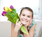 Happy girl with flowers Stock Photo
