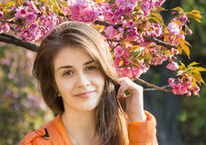 Happy girl in the flowers of sakura Stock Photography