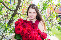 Happy girl with flowers in spring Stock Photo