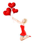 Happy girl flying, holding red heart balloons. Happy girl flying, female holding red heart balloons, woman having fun and laughing, body isolated on white Royalty Free Stock Images