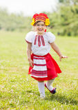 Happy girl in  folk clothes Stock Images
