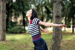 Happy girl in the forest. Happy girl stretching hands in the forest royalty free stock photos