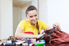 Happy girl founded thing in handbag Stock Photography
