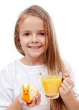 Happy girl with fresh orange juice Royalty Free Stock Images