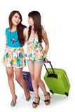 Happy girl friend going on vacation Stock Photo