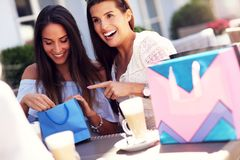 Happy girl friends in cafe during summer time Stock Photos