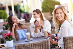 Happy girl friends in cafe during summer time Royalty Free Stock Image