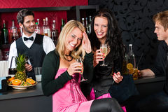 Happy girl friends with drinks enjoying party Stock Image