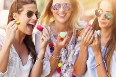 Happy girl friends hanging out in the city in summer royalty free stock photo