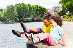 Happy girl friends playing by the river in summer stock photo