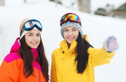 Happy girl friends in ski goggles outdoors Royalty Free Stock Photo