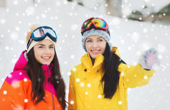 Happy girl friends in ski goggles outdoors Royalty Free Stock Photos