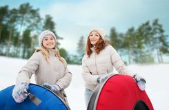 Happy girl friends with snow tubes outdoors Royalty Free Stock Photography