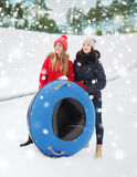 Happy girl friends with snow tubes outdoors Stock Images