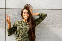 Happy girl in front of stone wall Royalty Free Stock Photo