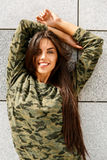 Happy girl in front of stone wall Stock Photo